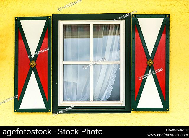 Typical window of a house in a small town in Austria. Home in the Austrian city of St Wolfgang in a rainy day. Retro style