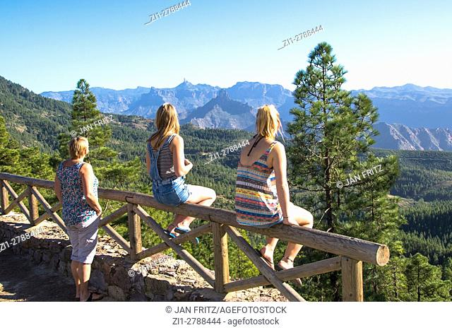 three persons enjoying view at Canaria islands, Spain