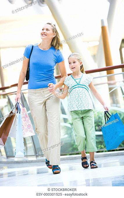 Mother and young daughter at a shopping mall