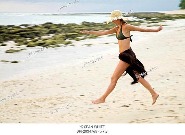 A Woman Tourist Walks On The Beach Of A Tropical Island, Koh Lanta Thailand