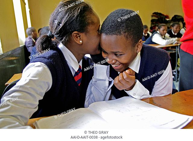 School girls whispering to each other in class, St Mark's School, Mbabane, Hhohho, Kingdom of Swaziland