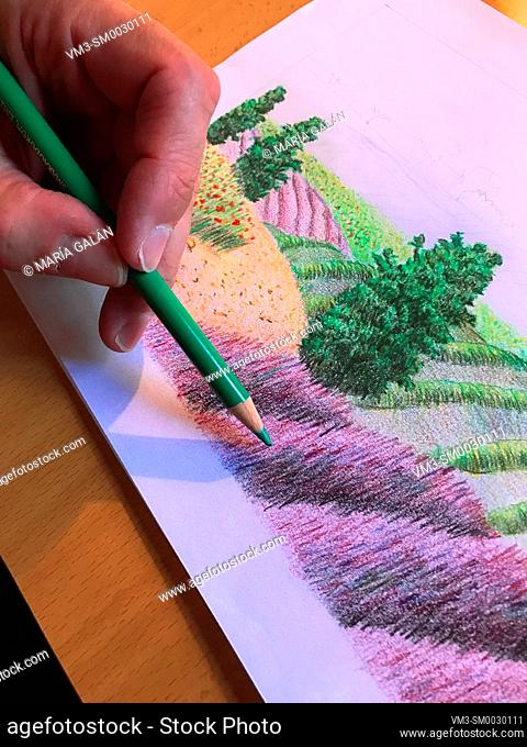 Hand drawing an illustration. Close view