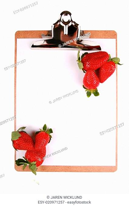 Strawberries on clipboard, healthy snack concept