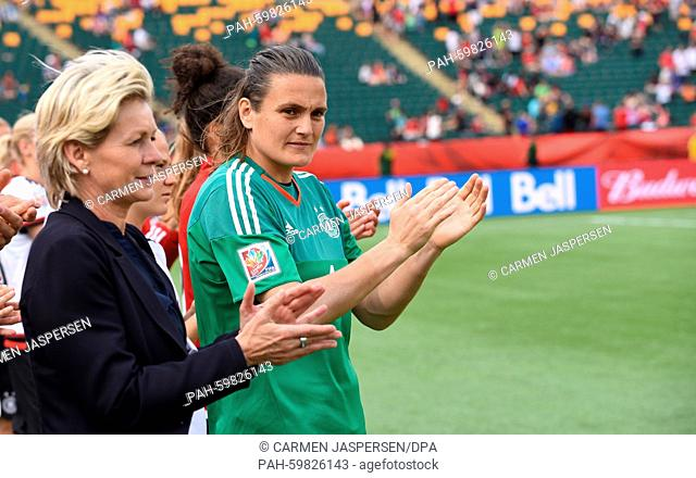 Germany's head coach Silvia Neid (L) and goalkeeper Nadine Angerer applaud England after the FIFA Women's World Cup 2015 third place soccer match between...