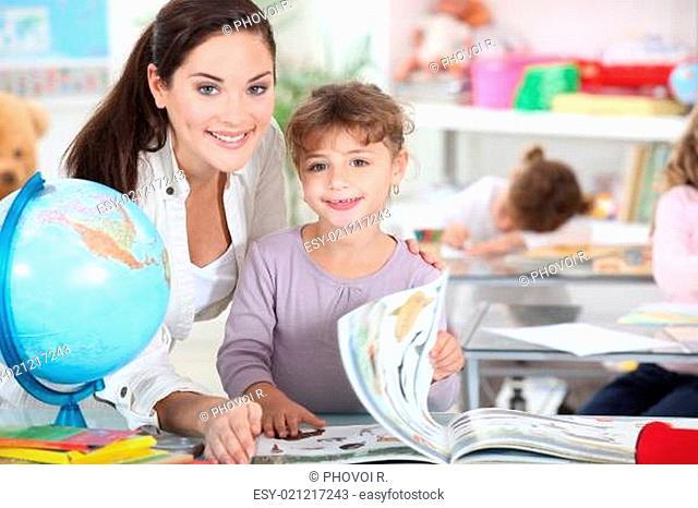 a female teacher and a little girl in a classroom