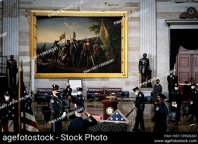 Capitol Police officers pay tribute to the late Capitol Police officer Brian Sicknick who lies in honor in the Rotunda of the Capitol in Washington