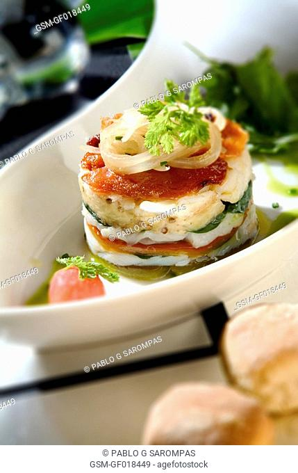 Escalivada roasted sweet peppers and aubergines vegetable and crystallized cod millefeuille pastry