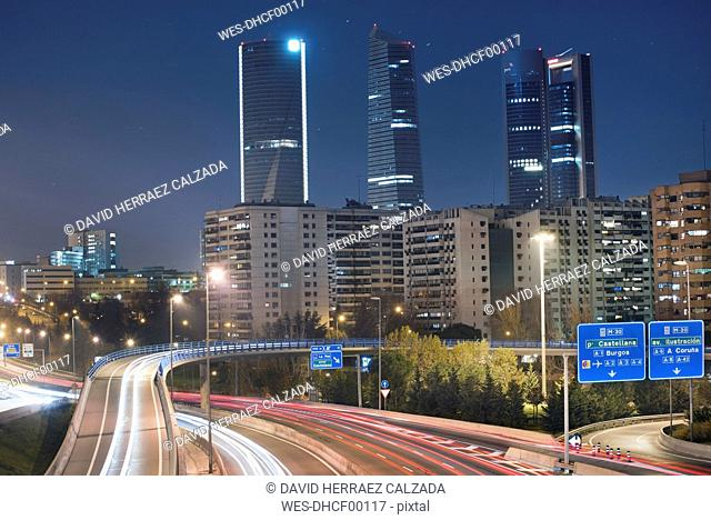 Spain, Madrid, financial district by night and rays of traffic lights