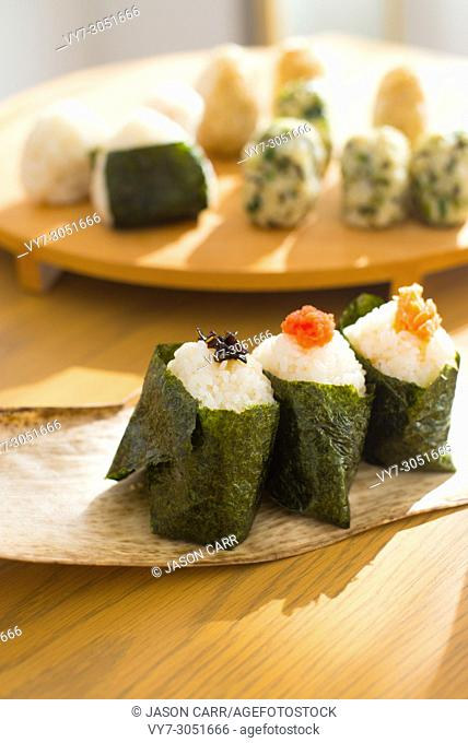 Set of Rice Ball 'Onigiri' is a typical meal in Japan. Japanese people grab some rice into balls with a shape of triangul in Tokyo, Japan
