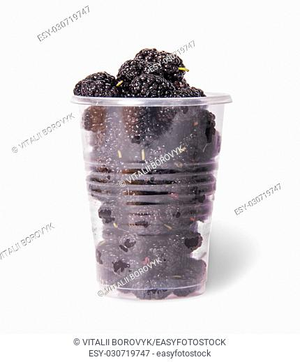 Mulberry in a plastic cup isolated on white background
