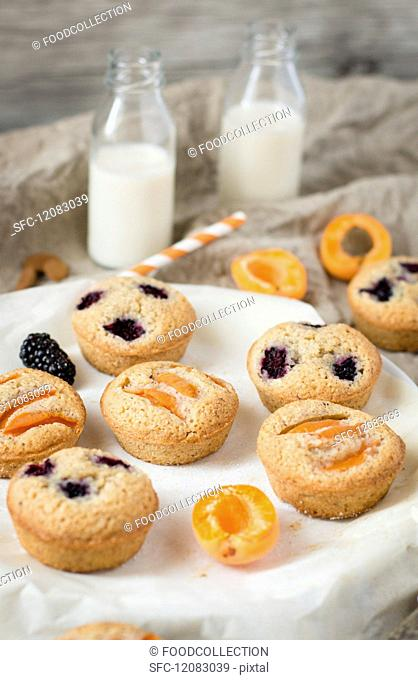 Financier cakes with apricots and blackberries