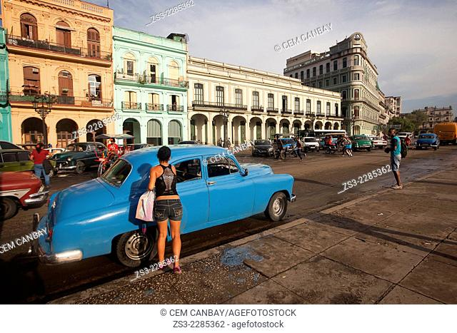Old american cars at the traffic in the city center, Havana, Cuba, West Indies, Central America