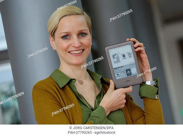 Managing partner of bookseller H. Hugendubel GmbH & Co. KG, Nina Hugendubel, poses with the eReader tolino in Berlin, Germany, 01 March 2013