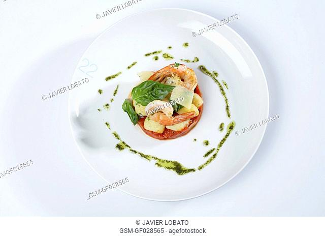 Potato gnocchi with tomato, basil and prawns
