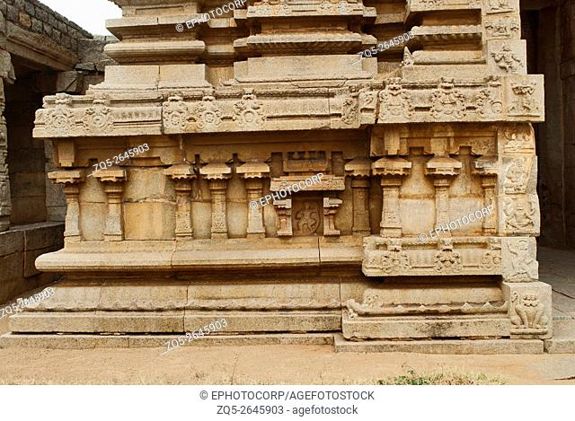 Carvings on the left side of the plinth. North Gopura of the inner courtyard, Achyuta Raya temple, Hampi, Karnataka, India. Sacred Center
