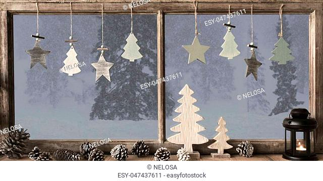 Window Frame With Grey Winter Landscape With Snow. View To Snowy Trees Outside With Snowflakes. Christmas Tree, Fir Cone And Lantern