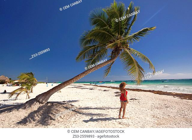 Woman posing on the beach, Tulum, Quintana Roo, Yucatan Province, Mexico, North America