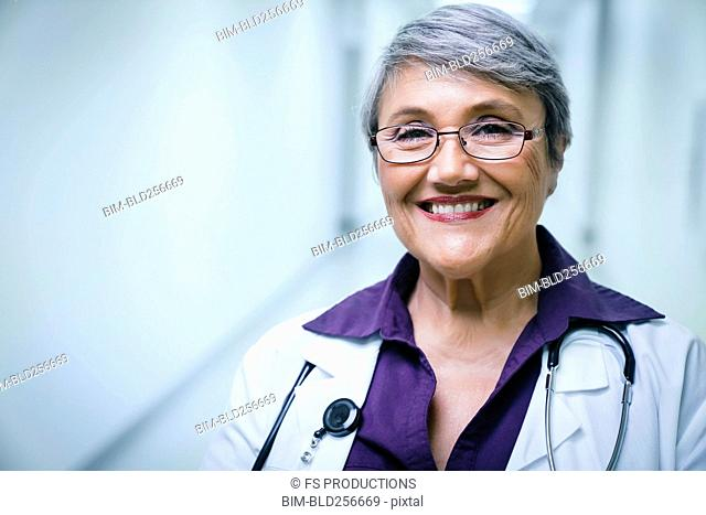 Portrait of smiling mixed race doctor