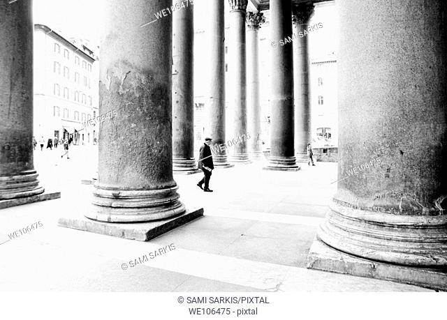 People walking in between the large columns of the Pantheon, Rome, Italy