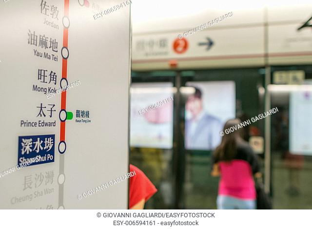 HONG KONG - APRIL 14, 2014: People in city subway. More than 90 percent of locals use the efficient public transportation system