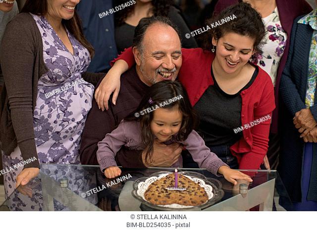 Multi-generation family celebrating birthday of older man