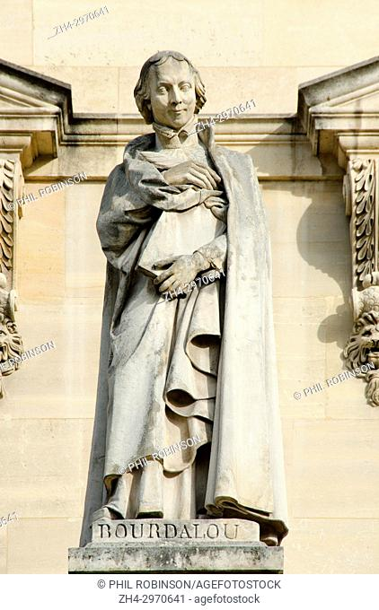 Paris, France. Palais du Louvre. Statue in the Cour Napoleon: Louis Bourdaloue (1632-1704) French Jesuit and preacher