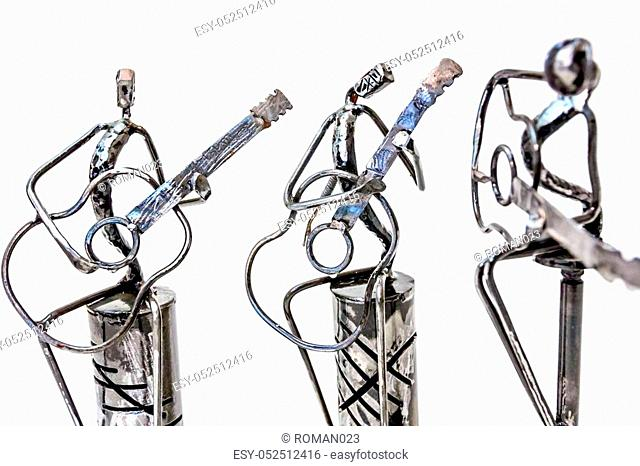 Figures of music performers made with welded black metal wire, guitarists are playing together living lines