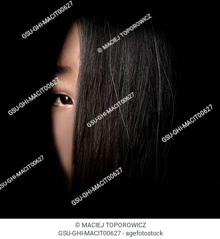 Portrait of Woman's Face Partially Covered with Long Hair