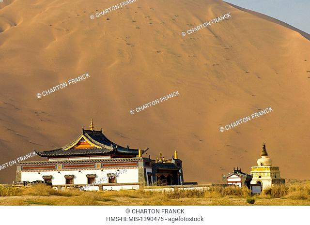 China, Inner Mongolia, giant sand dunes and multi-hued lakes of Badain Jaran, buddhiost temple by the Miao Shuan Haitze lake