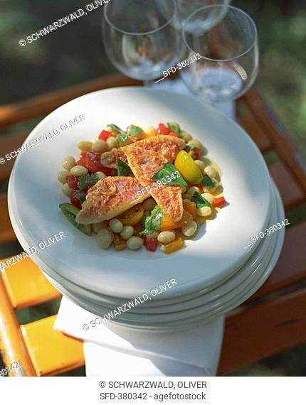 Red mullet with white beans and peppers