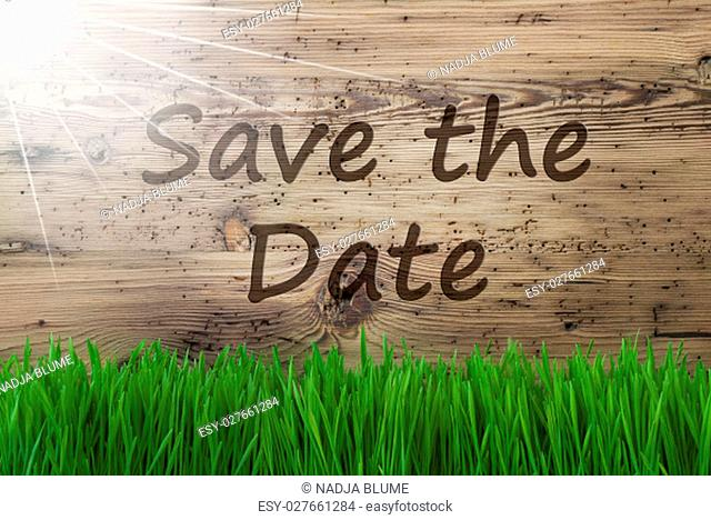 English Text Save The Date. Spring Season Greeting Card. Sunny Aged Wooden Background With Gras