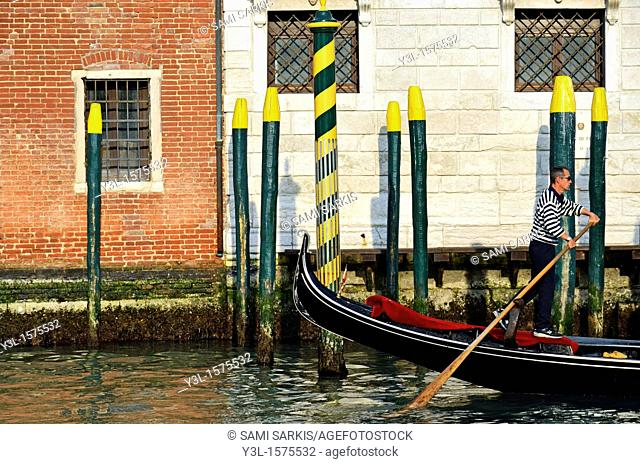 Gondola by buildings on Grand canal in Venice, Italy