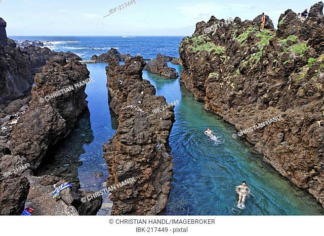 A natural swimming pool protected from the wild sea between volcanic rocks, Porto Moniz, Madeira, Portugal