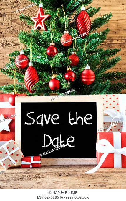 Chalkboard With English Text Save The Date. Colorful Christmas Card For Seasons Greetings. Christmas Tree With Balls. Gifts Or Presents In The Front Of Wooden...
