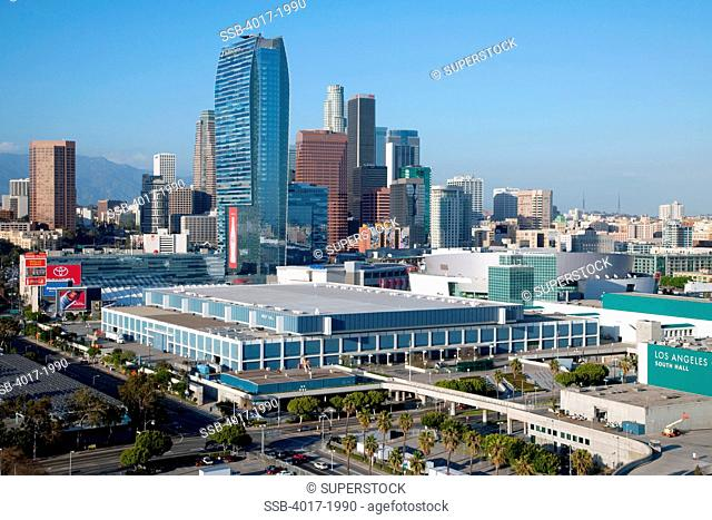 Aerial of the Los Angeles Convention Center and Staples Center Arena with the Downtown LA skyline behind them
