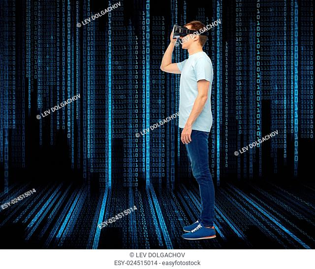 3d technology, virtual reality, entertainment, cyberspace and people concept - happy young man with virtual reality headset or 3d glasses over black background...