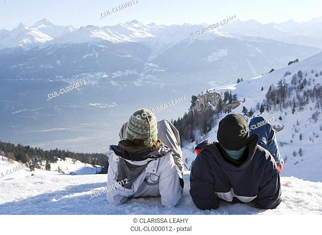 Young woman and man looking at view
