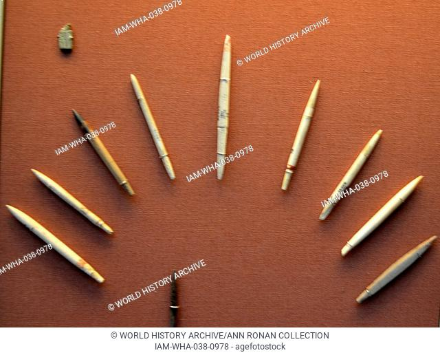 Collection of Funerary Tools and Labels 2000 B.C. Included in this collection is: Flint Tools, Bone Lable of King Djer and a label for an item of funerary...