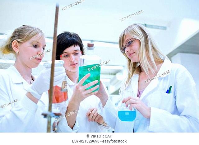 three female researchers carrying out research in a lab