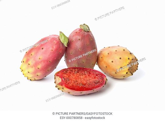 Whole and half prickly pears on white background