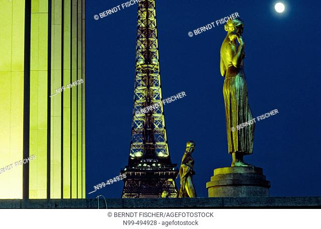 Eiffel tower, view from Palais Chaillot, Trocadéro, columns and statue, moon, Paris. France