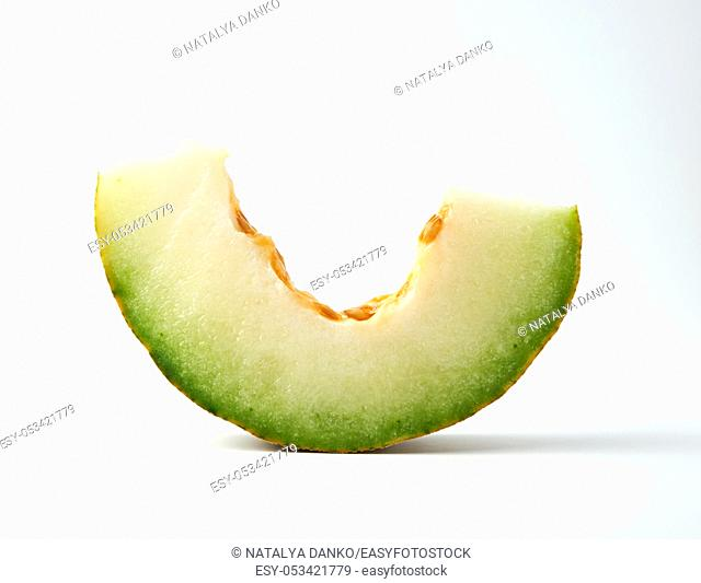 piece of ripe melon with seeds on a white background, close up