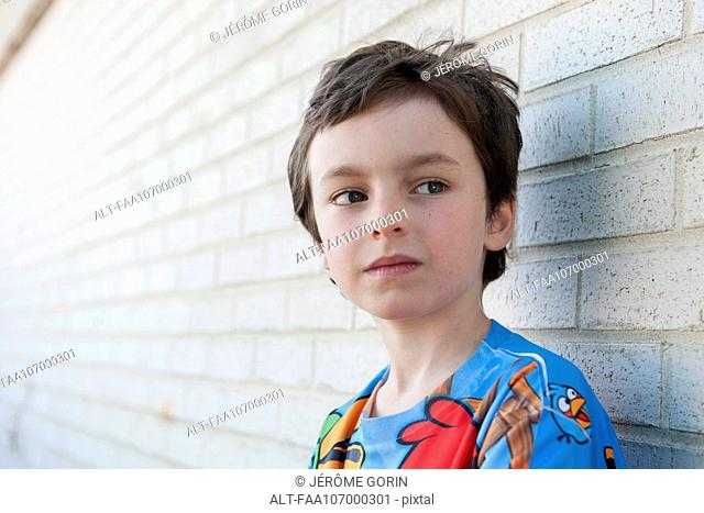 Boy looking away in thought, portrait
