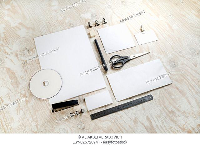 Photo of blank stationery set. Template for branding identity on light wooden background. For design presentations and portfolios