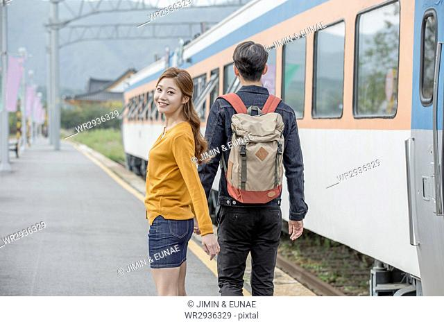 Young couple travelers at station