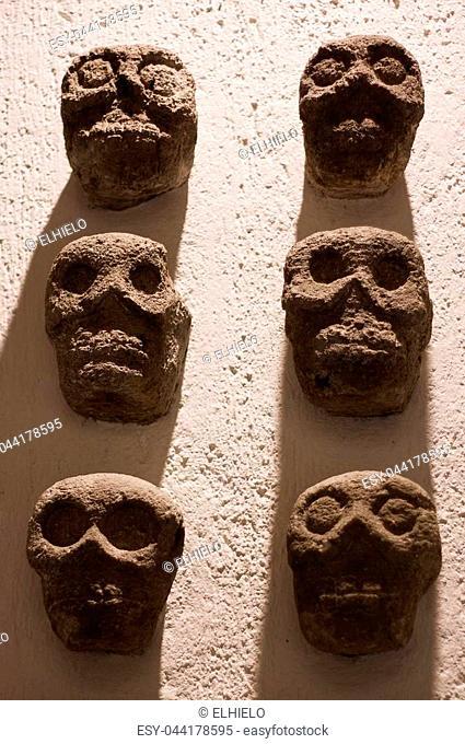 Mexico Oaxaca Santo Domingo monastery museum aztec sculls wall