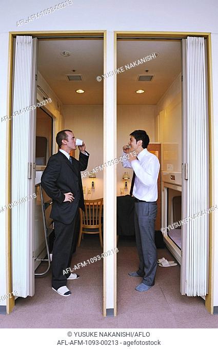 Businessmen in capsule hotel