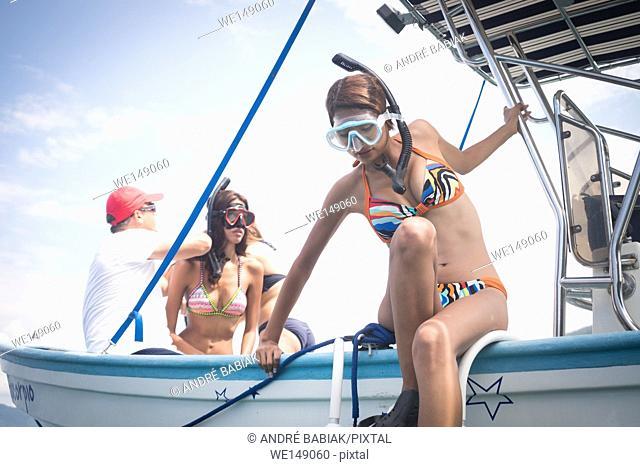 People preparing for diving off a boat. Banderas Bay - Pacific Ocean, Puerto Vallarta, Mexico