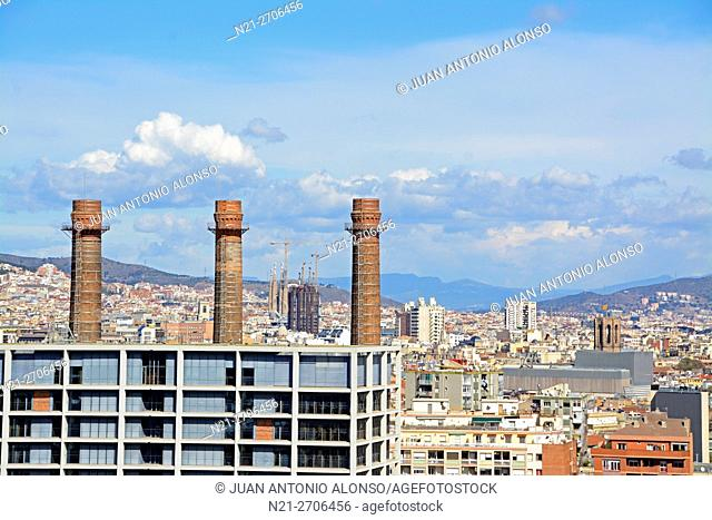 The three chimneys is a historical landmark. In the background we can see the Urquinaona Tower and the Sagrada Familia Temple