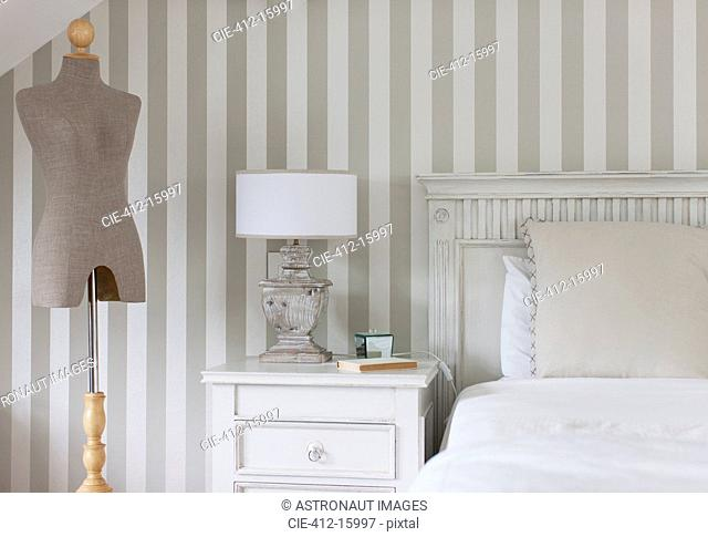 Dressmakers model and bed in feminine bedroom